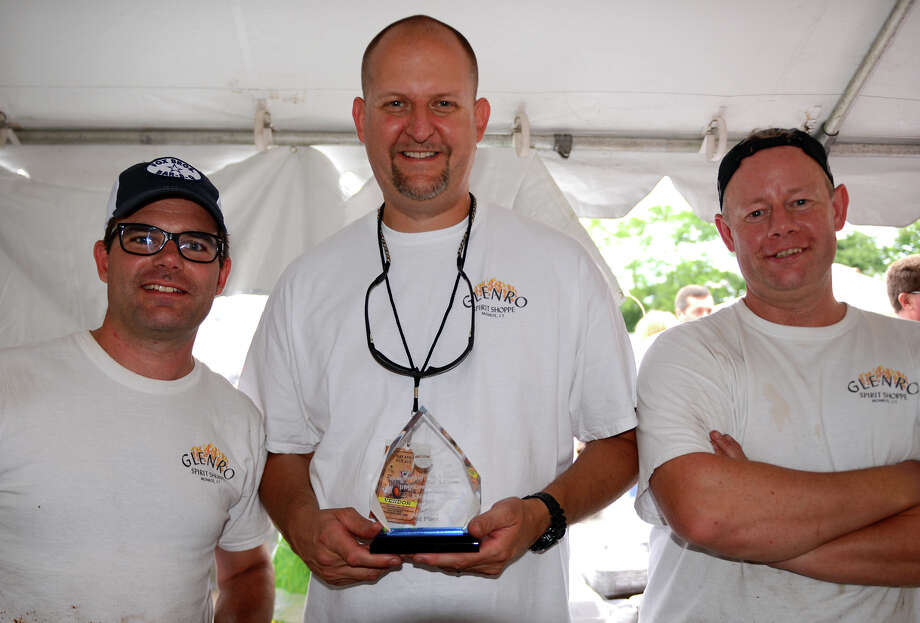 Guy Walker, left, Kris Yeager, and Stuart Monk, all of Monroe, won third place in the BBQ competition, during the 7th Annual Blues Views and BBQ Festival at the Levitt Pavillion in Westport, Conn. on Saturday, Aug. 30, 2014. Photo: Christian Abraham / Connecticut Post