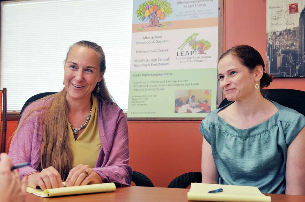 Kim Andersen, left, founder and director of Capital Region Language Center and Vicki Tremper, children's program director at the center, talk about the importance of children learning a second language Thursday, July 31, 2014, during an interview in Albany, N.Y. (Paul Buckowski / Times Union)