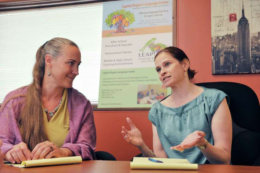 Kim Andersen, left, founder and director of Capital Region Language Center and Vicki Tremper, children's program director at the center, talk about the importance of children learning a second language during an interview on Thursday, July 31, 2014, in Albany, N.Y. (Paul Buckowski / Times Union)