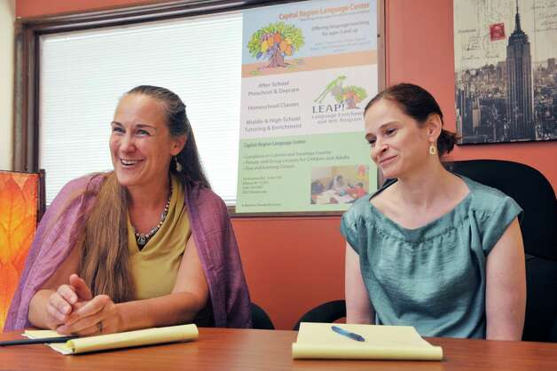 Kim Andersen, left, founder and director of Capital Region Language Center and Vicki Tremper, children's program director at the center, talk about the importance of children learning a second language Thursday, July 31, 2014, during an interview in Albany, N.Y.  (Paul Buckowski / Times Union) Photo: Paul Buckowski / 00027905A