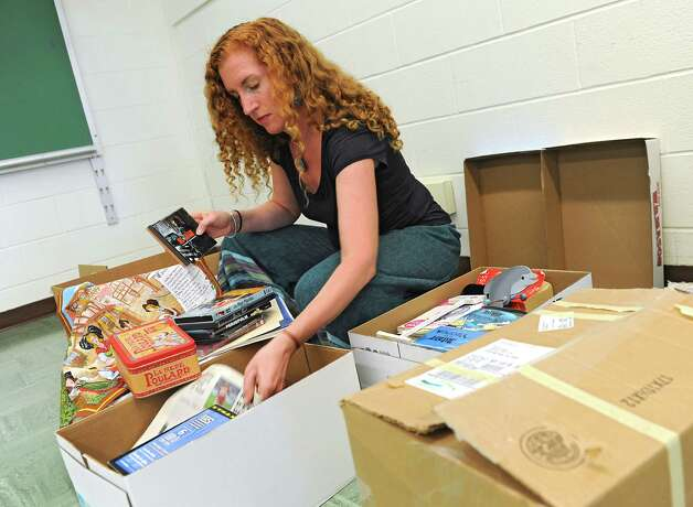 Shenendehowa french teacher Jessica Palden goes through boxes as she sets up her classroom for the coming school year Monday, Aug. 18, 2014 in Clifton Park, N.Y. (Lori Van Buren / Times Union) Photo: Lori Van Buren / 00028189A