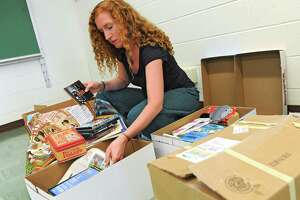 Shenendehowa french teacher Jessica Palden goes through boxes as she sets up her classroom for the coming school year Monday, Aug. 18, 2014 in Clifton Park, N.Y. (Lori Van Buren / Times Union)