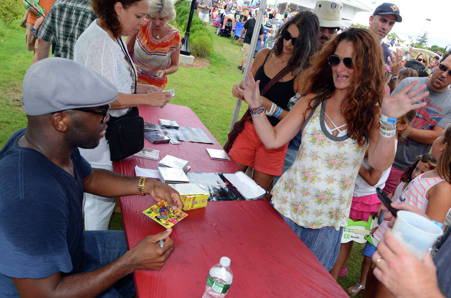 Jen Boudin, of Long Island, gets an autograph from Sam Williams, of Big Sam's Funky Nation, during the 7th Annual Blues Views and BBQ Festival at the Levitt Pavillion in Westport, Conn. on Saturday, Aug. 30, 2014. Photo: Christian Abraham / Connecticut Post