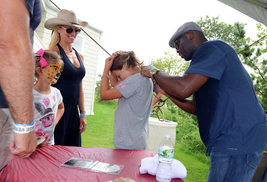 Tori Emmert, 9, of Westport, gets her shirt autographed by Sam Williams, of Big Sam's Funky Nation, during the 7th Annual Blues Views and BBQ Festival at the Levitt Pavillion in Westport, Conn. on Saturday, Aug. 30, 2014. Photo: Christian Abraham / Connecticut Post
