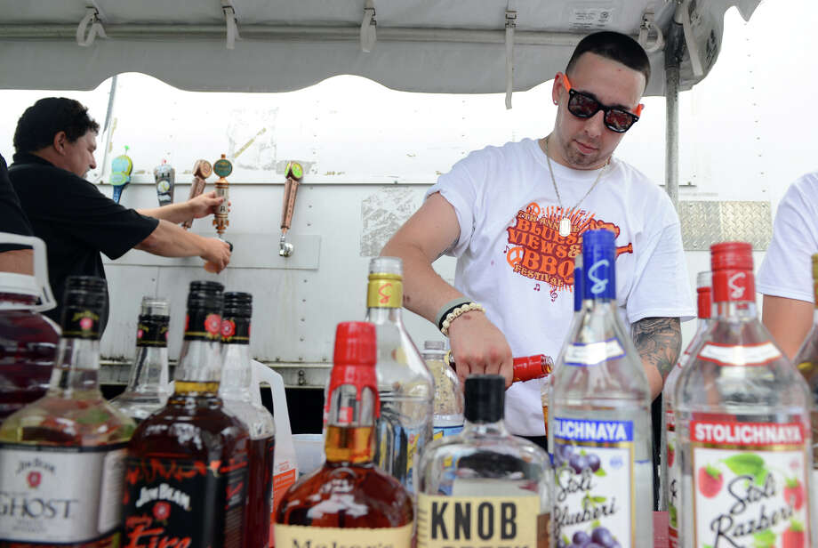 Bartender Sam Price, during the 7th Annual Blues Views and BBQ Festival at the Levitt Pavillion in Westport, Conn. on Saturday, Aug. 30, 2014. Photo: Christian Abraham / Connecticut Post