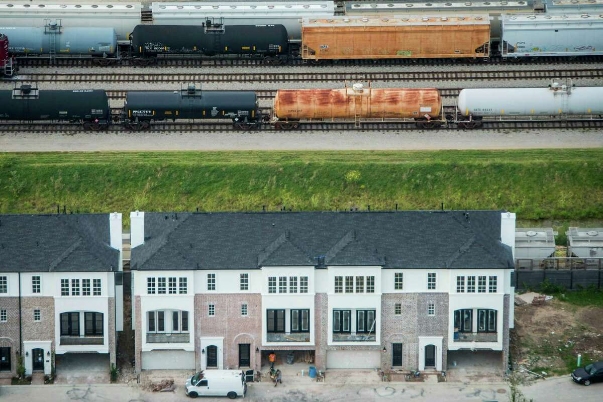 """Oil in train cars like these behind a Washington Avenue-area development in Houston, grew nationally from 9,500 in 2008 to more than 400,000 last year, says the Association of American Railroads. """"Data on rail transportation is limited,"""" an official with the Texas Railroad Commission admits."""