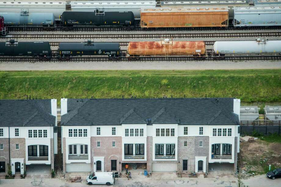 """Oil in train cars like these behind a Washington Avenue-area development in Houston, grew nation-ally from 9,500 in 2008 to more than 400,000 last year, says the Association of American Railroads. """"Data on rail transportation is limited,"""" an official with the Texas Railroad Commission admits. Photo: Smiley N. Pool, Staff / © 2014  Houston Chronicle"""