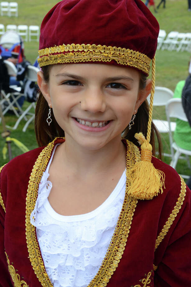 "Junior Odessa Dancer Olivia Chomiak, 8, of Bethany, during the annual ""Odyssey: A Greek Festival"" held at St. Barbara Greek Orthodox Church in Orange, Conn. on Saturday, Aug. 30, 2014. The festival continues on Sunday from noon to 10 p.m. and on Monday from noon to 8 p.m. Photo: Christian Abraham / Connecticut Post"