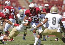 Stanford's Kelsey Young, (39) runs for a first quarter first down, as the Stanford Cardinal takes on the UC Davis Aggies, at Stanford stadium in Palo Alto, Calif., on Saturday Aug. 30, 2014.
