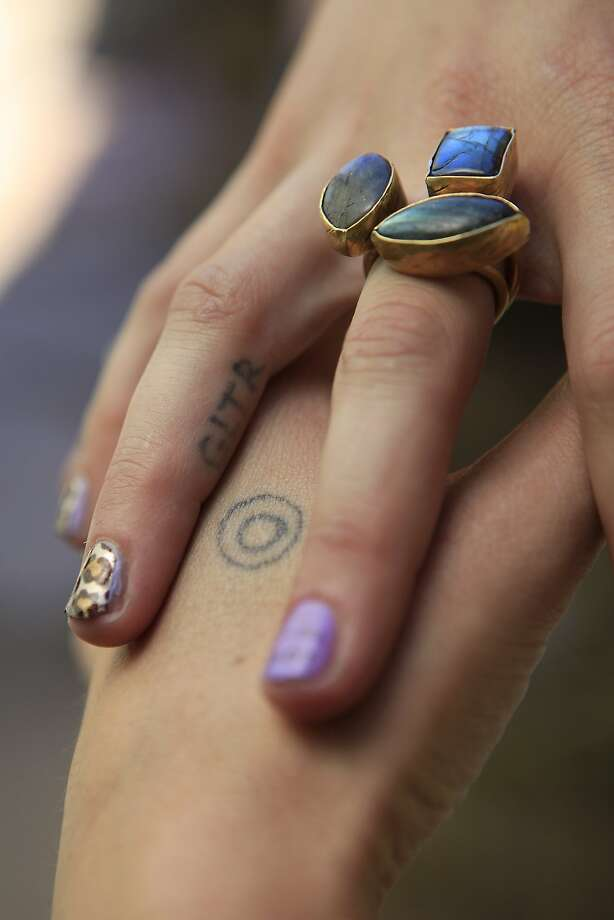 Hanna Cohen of San Francisco, friend of Stick and Poke creator Nicole West, shows her home tattoos on her hand and finger. Photo: Michael Short, The Chronicle
