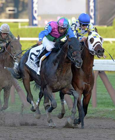 Itsmyluckyday with jockey Paco Lopez in the irons, left out duels Moreno with jockey Junior Alvarado to the wire to win the 61st running of The Woodward Saturday evening Aug. 30, 2014 at the Saratoga Race Course in Saratoga Springs, N.Y.     (Skip Dickstein/Times Union) Photo: SKIP DICKSTEIN