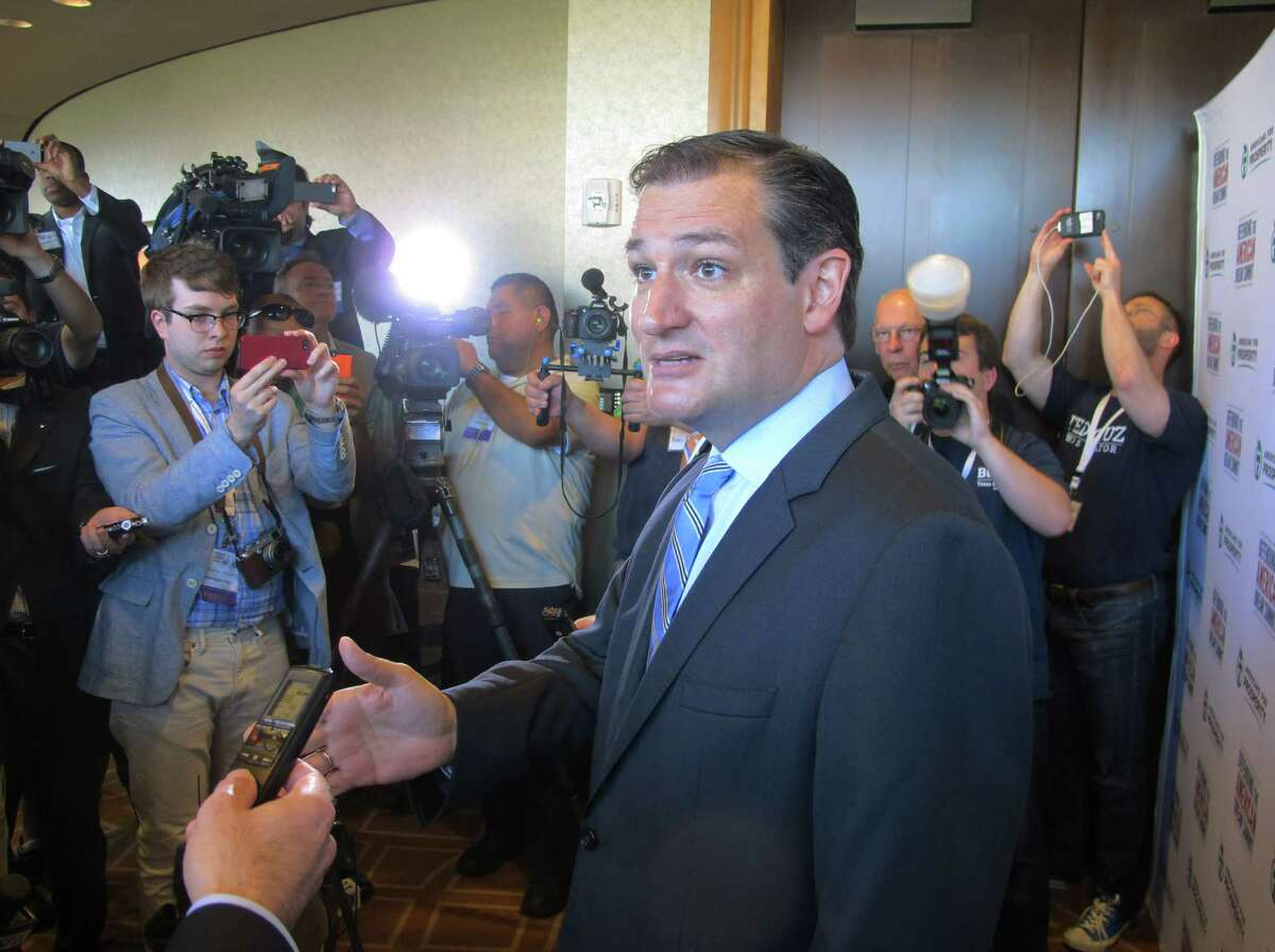 """U.S. Sen. Ted Cruz, R-Texas, speaks to reporters after his speech at the Americans for Prosperity Summit in Dallas on Saturday, Aug. 30, 2014. He told the influential gathering of conservative activists Saturday that """"we are part of a grassroots fire that is sweeping this country."""" (AP Photo/Will Weissert)"""