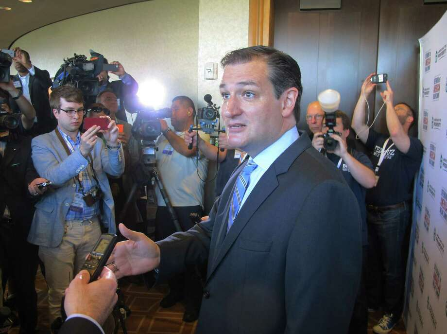 "U.S. Sen. Ted Cruz, R-Texas, speaks to reporters after his speech at the Americans for Prosperity Summit in Dallas on Saturday, Aug. 30, 2014. He told the influential gathering of conservative activists Saturday that ""we are part of a grassroots fire that is sweeping this country."" (AP Photo/Will Weissert) Photo: Will Weissert, STF / AP"