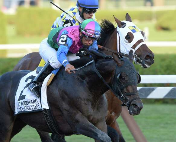 Itsmyluckyday with jockey Paco Lopez in the irons, out duels Moreno with jockey Junior Alvarado to the wire to win the 61st running of The Woodward Saturday evening Aug. 30, 2014 at the Saratoga Race Course in Saratoga Springs, N.Y.     (Skip Dickstein/Times Union) Photo: SKIP DICKSTEIN