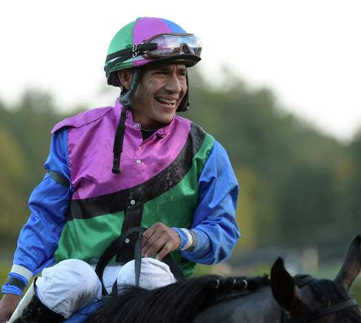 Jockey Paco Lopez is all smiles as he heads to the winner's circle after winning the 61st running of The Woodward Saturday evening Aug. 30, 2014 at the Saratoga Race Course in Saratoga Springs, N.Y.     (Skip Dickstein/Times Union) Photo: SKIP DICKSTEIN