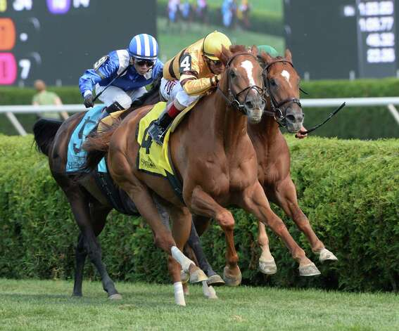 Two-time  horse of the year Wise Dan with jockey John Velazquez in the saddle wins the 56th running of the Bernard Baruch which he won Saturday afternoon Aug. 30, 2014 at the Saratoga Race Course in Saratoga Springs, N.Y.     (Skip Dickstein/Times Union) Photo: SKIP DICKSTEIN