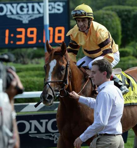 Two-time horse of the year Wise Dan with jockey John Velazquez returns to the winner's circle after winning the 56th running of the Bernard Baruch which he won Saturday afternoon Aug. 30, 2014 at the Saratoga Race Course in Saratoga Springs, N.Y.     (Skip Dickstein/Times Union) Photo: SKIP DICKSTEIN
