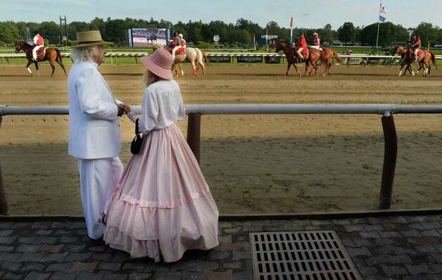 Mark Twain reenact ors Don and Kat Coons of Cobleskill stand in the winner's circle to promote their reenactment to be held at the MacGregor Historical Cottage on the 13 and 14th of September, Saturday afternoon Aug. 30, 2014 at the Saratoga Race Course in Saratoga Springs, N.Y.     (Skip Dickstein/Times Union) Photo: SKIP DICKSTEIN