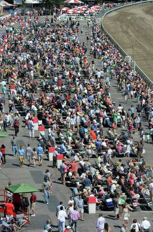 Another large crowd was on hand Saturday afternoon Aug. 30, 2014 at the Saratoga Race Course in Saratoga Springs, N.Y.     (Skip Dickstein/Times Union) Photo: SKIP DICKSTEIN