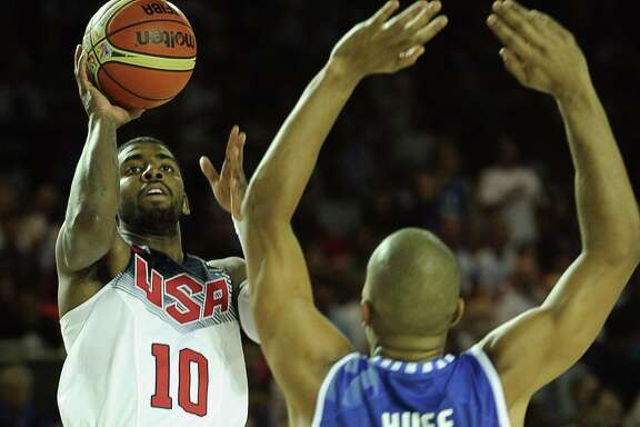 U.S. guard Kyrie Irving puts up a shot over Finland forward Shawn Huff in the Americans' victory.