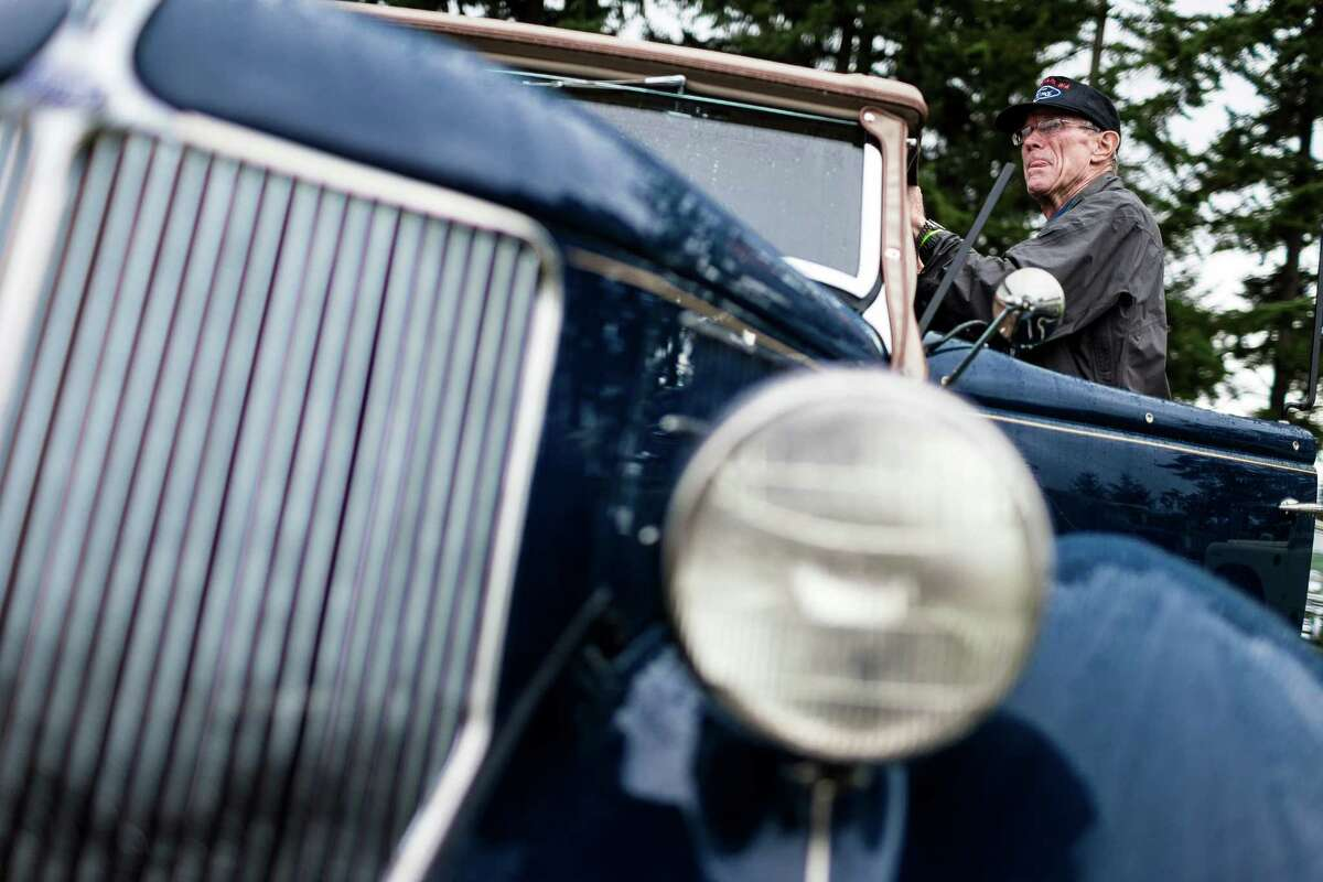 Owners prep their vintage vehicles to go up for auction.