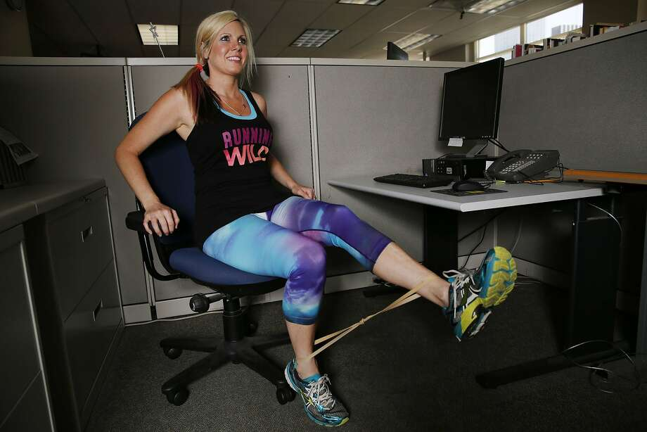 Personal trainer Kristi Dear demonstrates exercises that can be done in the workplace. People with college degrees tend to be more sedentary than those without high school diplomas. Photo: Andy Jacobsohn, McClatchy-Tribune News Service