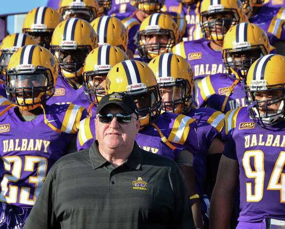 UAlbany head coach Greg Gattuso leads his team onto the field for Saturday's season opener against  Holy Cross at Bob Ford Field in Albany, NY.   (John Carl D'Annibale / Times Union) Photo: John Carl D'Annibale / 00028391A