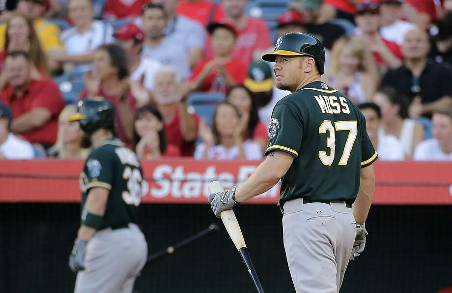 Oakland Athletics' Brandon Moss (37) walks off the field after striking out during the first inning of a baseball game against the Los Angeles Angels, Saturday, Aug. 30, 2014, in Anaheim, Calif. (AP Photo/Jae C. Hong) Photo: Jae C. Hong, Associated Press