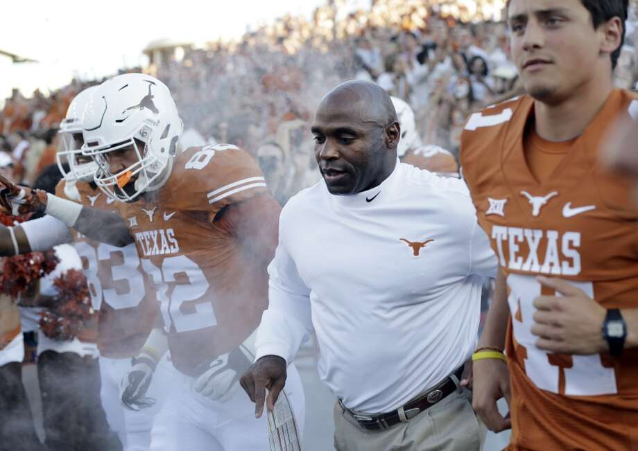 Texas coach Charlie Strong, center, runs on to the field with his team for this first game as head coach before an NCAA college football game against North Texas, Saturday, Aug. 30, 2014, in Austin, Texas. (AP Photo/Eric Gay) Photo: Eric Gay, Associated Press