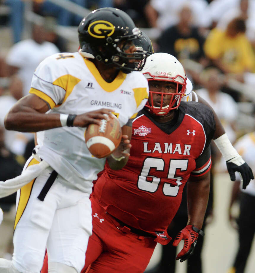Lamar's Omar Tebo, No. 65, moves in on Grambling State quarterback D.J. Williams during Saturday's game. The Lamar Cardinals opened their season Saturday evening against the Grambling State Tigers at Provost Umphrey Stadium. Photo taken Saturday 8/30/14 Jake Daniels/@JakeD_in_SETX Photo: Jake Daniels / ©2014 The Beaumont Enterprise/Jake Daniels