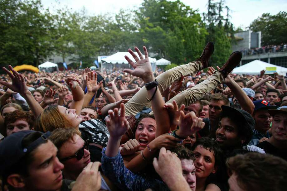 A woman crowd surfs as Danny Brown performs at the Fisher Green Stage. Photo: JOSHUA TRUJILLO, SEATTLEPI.COM / SEATTLEPI.COM