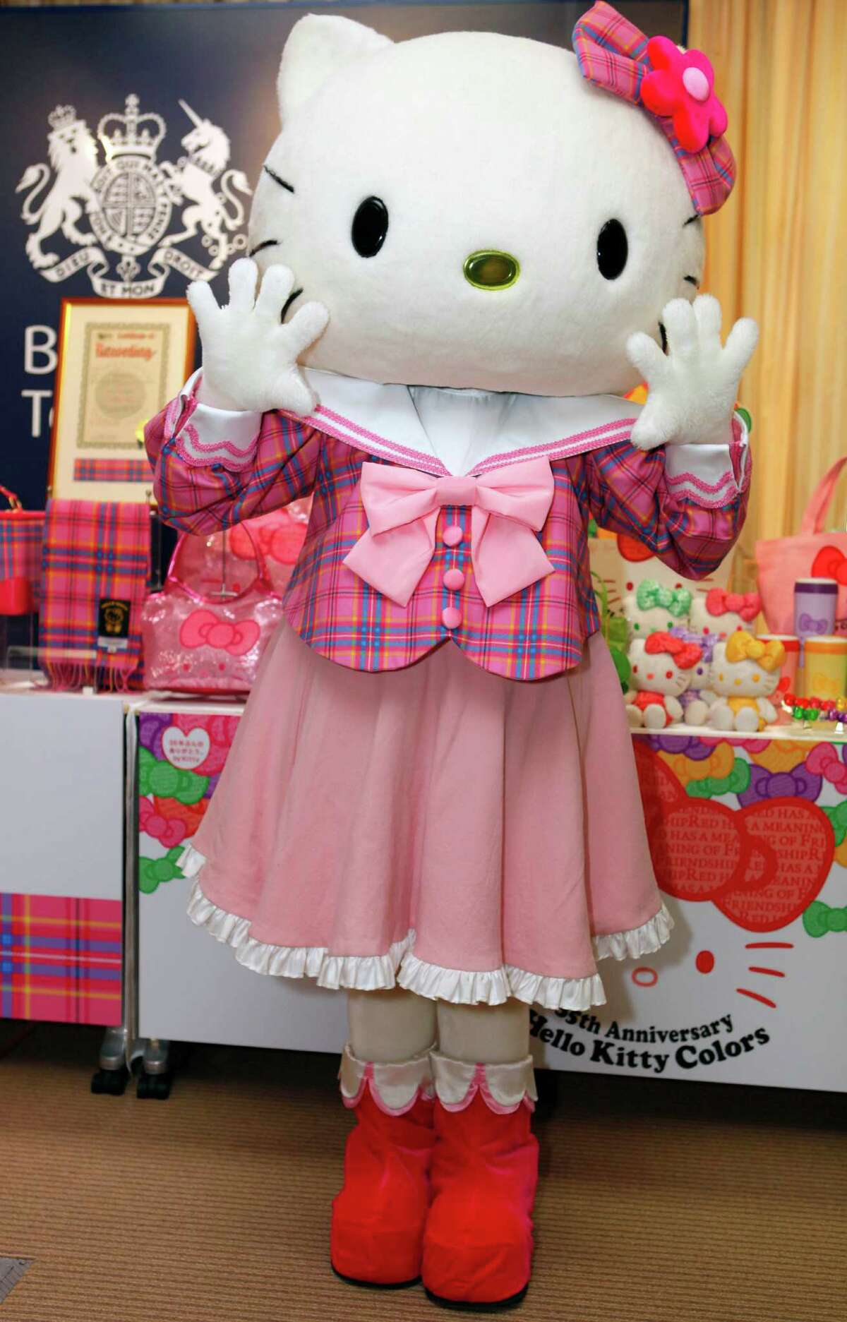 FILE - In this June 10, 2009 file photo, Hello Kitty poses in its original tartan blouse and ribbon during a news conference to unveil