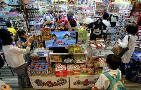 e14d0e58a Shoppers gather around the items featuring Youkai Watch characters at Kiddy  Land toy store in Tokyo