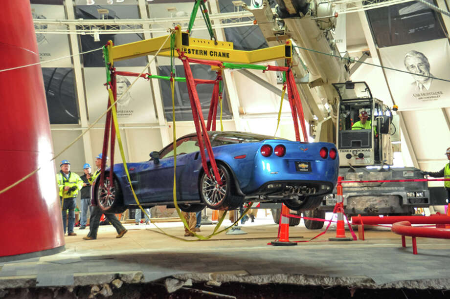 "Workers use a crane to recover the first Chevrolet Corvette, the 2009 Corvette ZR-1 ""Blue Devil,"" from the sinkhole at the National Corvette Museum on Monday, March 3, 2014 in Bowling Green, Kentucky. The vehicle, along with seven other Corvettes, fell into the sinkhole February 12. The ZR-1 appears to have sustained minimal damage after its nearly 30-foot fall. The ""Blue Devil"" started up and drove out of the museum under its own power. (Photo by Bob Bubnis/National Corvette Museum for Chevrolet) Photo: Bob Bubnis, Bob Bubnis/National Corvette Mus / © 2014 Bob Bubnis and General Motors. This image is protected by copyright but provided for use under a Creative Commons 3.0 License for the purpose of editorial comment only. The use of this image for advertising, marketing, or any other commercial purposes is prohibited. This image can be cropped, but may not be altered in any other way, and each should bear the credit line ""© GM Company."" General Motors makes no representations with respect to the consent of those persons appearing in these photos, or with regard to the use of names, trademarks, trade dress, copyrighted designs or works of art or architecture that are not the intellectual property of General Motors Company."