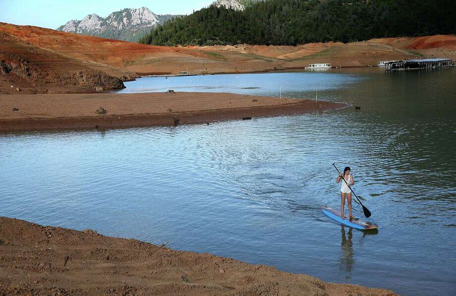 "Shasta Lake, California's largest reservoir, saw historic low water levels due to a four year drought.  Above average rains and mountain snows this winter have brought what UW atmospheric science professor Cliff Mass calls ""a precipitous and huge increase in water storage."" Photo: Justin Sullivan, Getty Images / 2014 Getty Images"