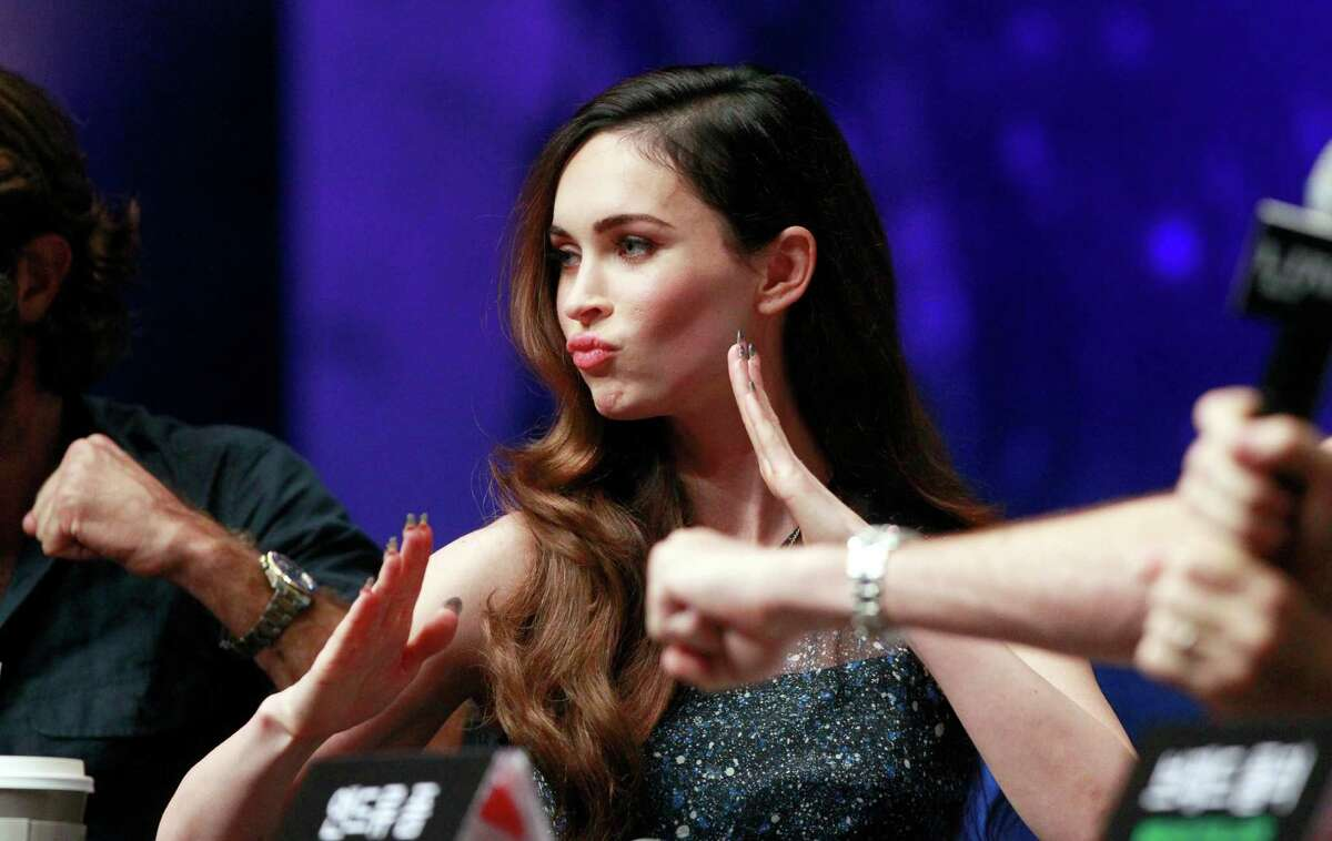 Megan Fox poses for photographers during a press conference for her latest film