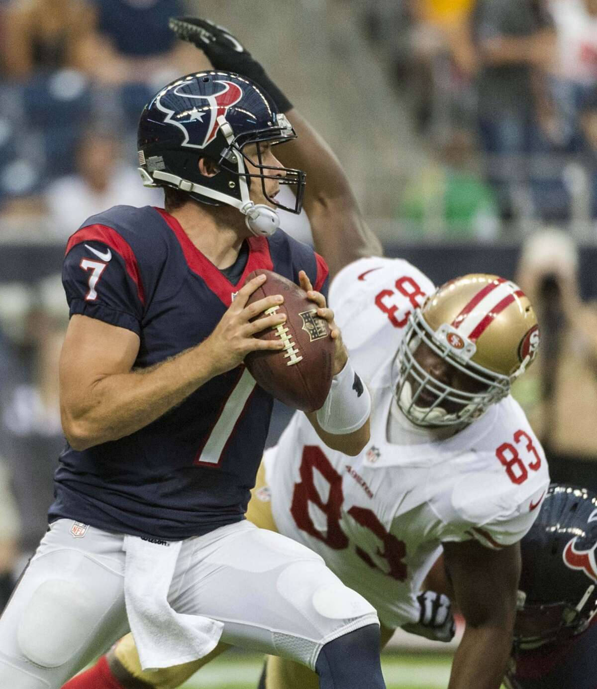 Houston Texans quarterback Case Keenum (7) tries to elude the rush from San Francisco 49ers tight end Demarcus Dobbs (83) during the first quarter of an NFL preseason football game at NRG Stadium on Thursday, Aug. 28, 2014, in Houston. ( Smiley N. Pool / Houston Chronicle )