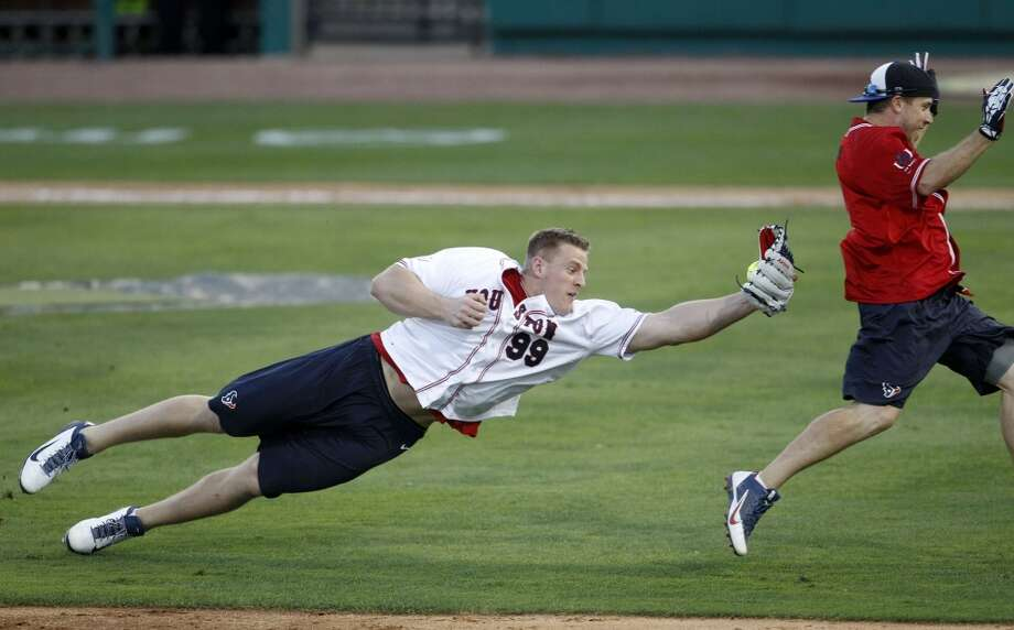 J.J. Watt dives to tag out Case Keenum  during the softball game during the J.J. Watt 2014 Charity Classic at Constellation Field, Friday, May 2, 2014, in Houston. ( Karen Warren / Houston Chronicle  ) Photo: Houston Chronicle