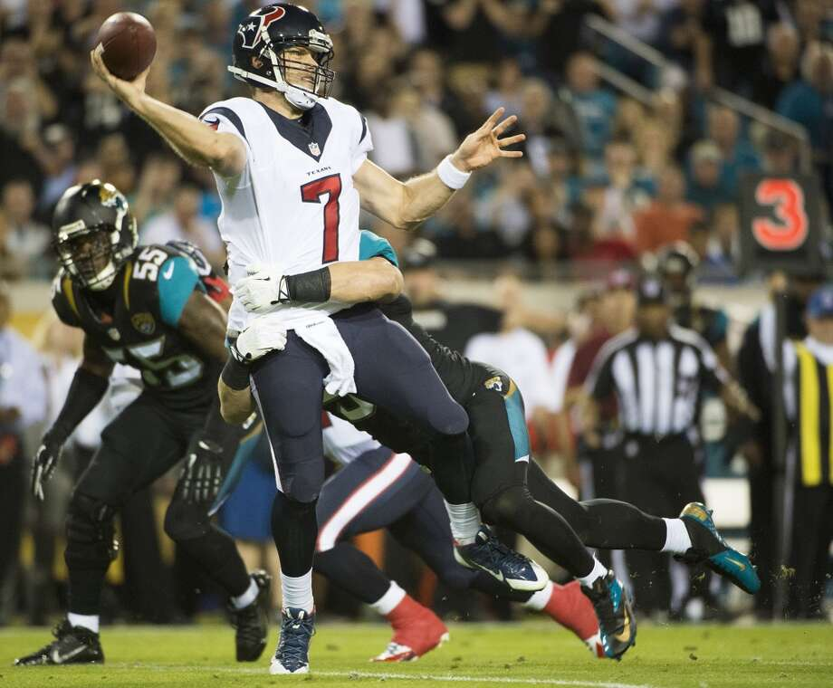 Houston Texans quarterback Case Keenum (7) gets off a pass as he is hit by Jacksonville Jaguars middle linebacker Paul Posluszny (51) during the first quarter of an NFL football game against the Jacksonville Jaguars on Thursday, Dec. 5, 2013, at Ever Bank Field in Jacksonville, FL. ( Smiley N. Pool / Houston Chronicle ) Photo: Houston Chronicle