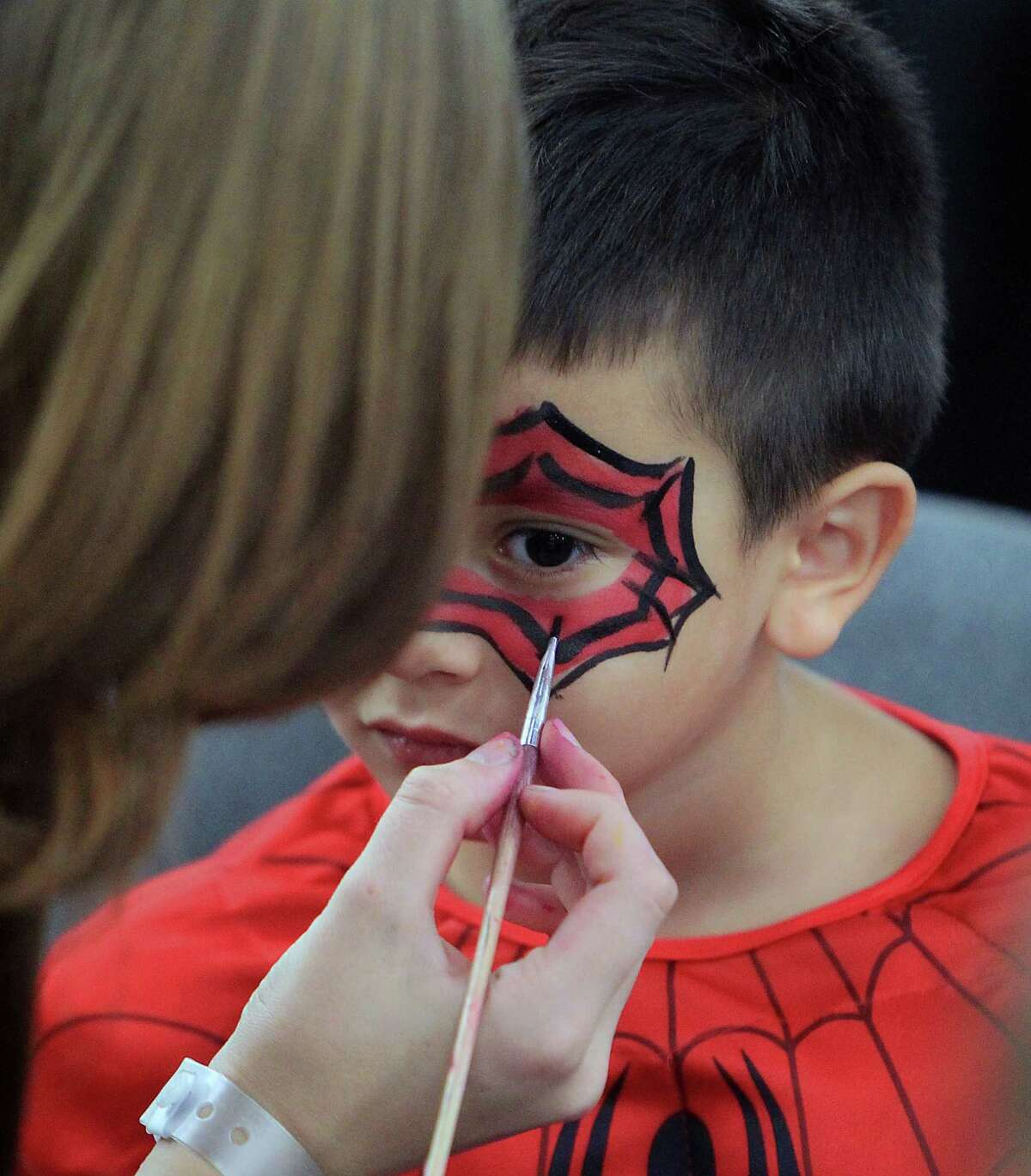 Four-year-old Michael Thornton has his face painted during the Amazing Houston Comic Con convention at George R Brown Convention Center Sunday, Aug. 31, 2014, in Houston.