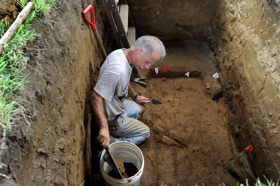 Connecticut State archaeologist Nick Bellantoni, who plans to retire this fall, works in a gravesite at Wooster Cemetery in Danbury, Tuesday, Aug. 14, 2012. Bellantoni found partial remains of Albert Afraid of Hawk, who performed with the Buffalo Bill Wild West Show and died in Danbury in 1900. Photo: Carol Kaliff / The News-Times