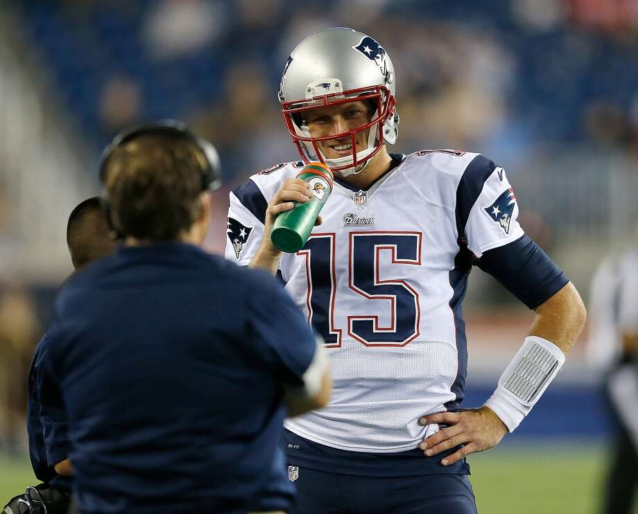 FOXBORO, MA - AUGUST 15: Ryan Mallett #15 of the New England Patriots smiles as he confers with Bill Belichick during their pre-season game with the Philadelphia Eagles at Gillette Stadium on August 15, 2014 in Foxboro, Massachusetts. (Photo by Jim Rogash/Getty Images) Photo: Jim Rogash, Getty Images