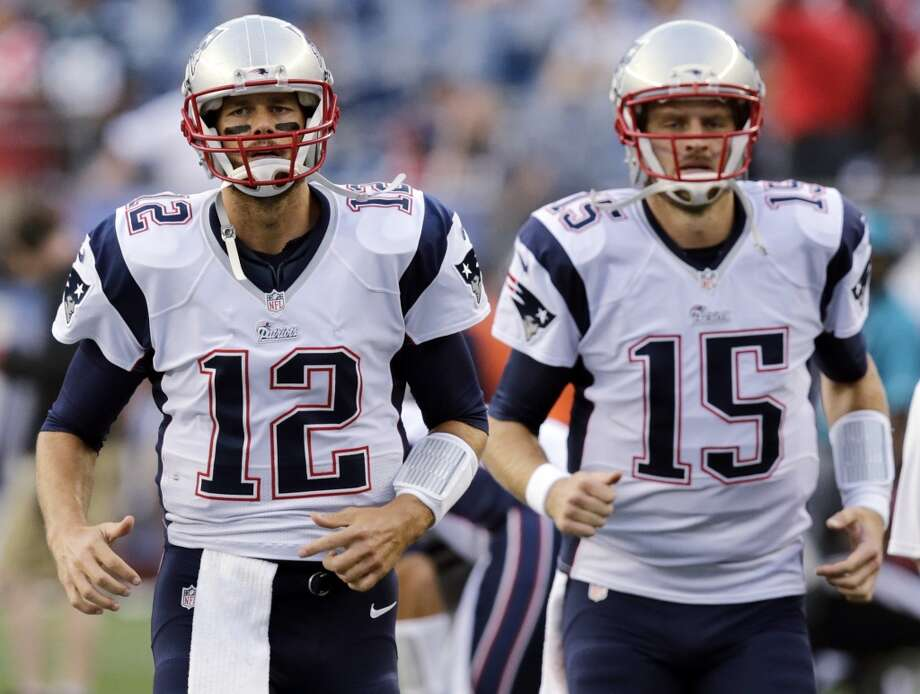 New England Patriots quarterback Tom Brady (12) and quarterback Ryan Mallett, run before an NFL preseason football game Friday, Aug. 22, 2014, in Foxborough, Mass. (AP Photo/Charles Krupa) Photo: Charles Krupa, Associated Press