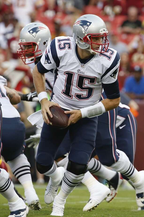 New England Patriots quarterback Ryan Mallett turns out of the pocket during the first half of an NFL preseason football game against the Washington Redskins in Landover, Md., Thursday, Aug. 7, 2014. (AP Photo/Alex Brandon) Photo: Alex Brandon, Associated Press