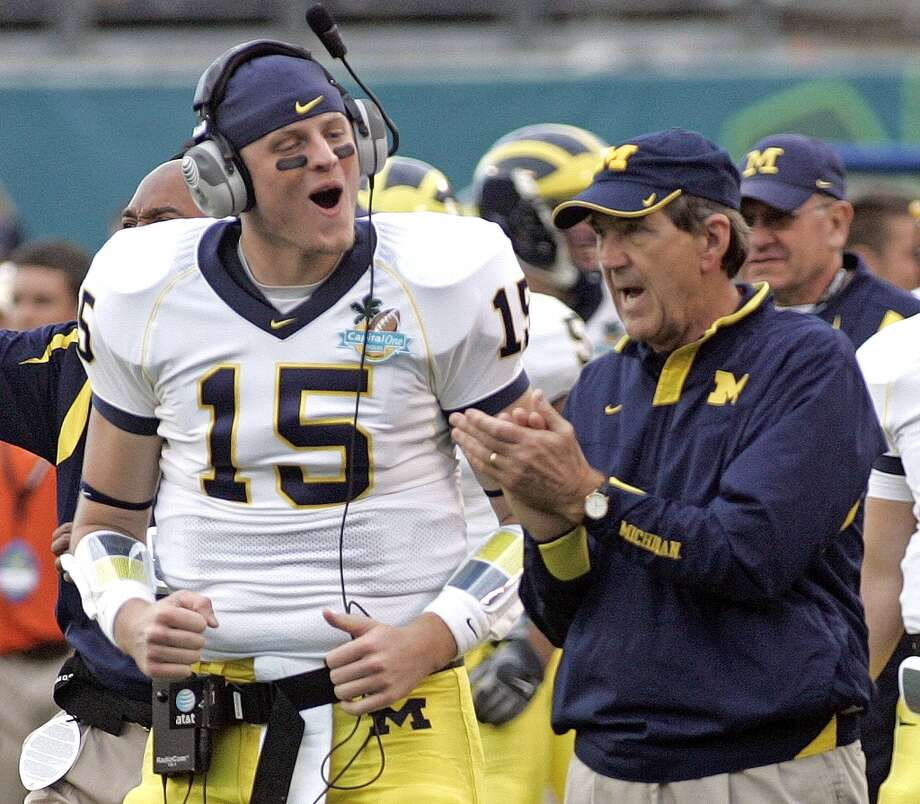 Michigan quarterback Ryan Mallett (15) celebrates with head coach Lloyd Carr as time runs out in the fourth quarter of the Capital One Bowl football game against Florida in Orlando, Fla., Tuesday, Jan. 1, 2008. Michigan won 41-35.(AP Photo/Reinhold Matay) Photo: Reinhold Matay, AP