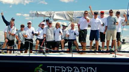 The crew of the Terrapin, owned by Jonathan Litt of Greenwich head out for the Labor Day weekend's Vineyard Race, a 238-mile course got underway in Stamford Harbor in Stamford, Conn. on Friday, Aug. 29, 2014.