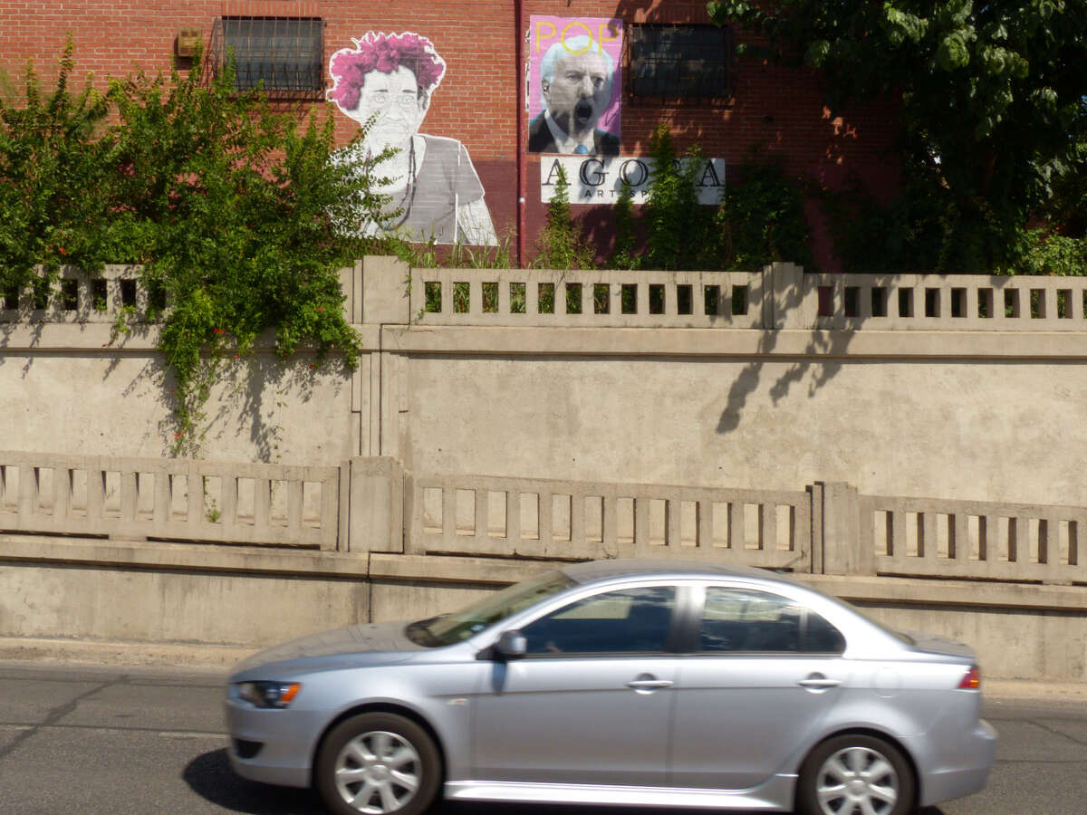 San Antonio artist Jorge Villarreal has placed two pieces of art, one of a Cuban woman, and the other of San Antonio Spurs basketball coach Gregg Popovich, on the side of a building along Roosevelt Avenue in the King William District. Thursday, August 28, 2014.
