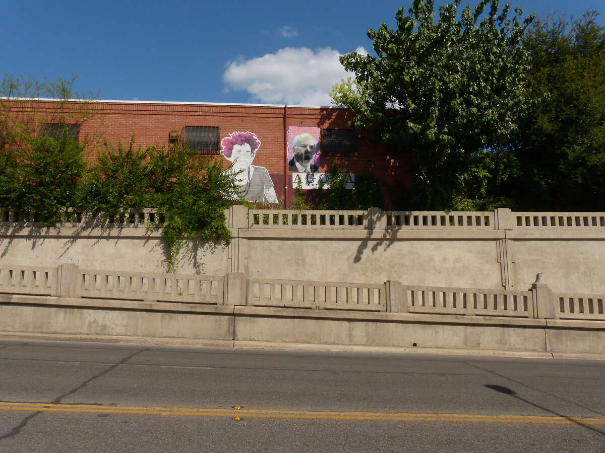 Portraits of a Cuban woman and San Antonio Spurs basketball coach Gregg Popovich are seen on a building on Roosevelt Avenue in the King William District. Thursday, August 28, 2014.
