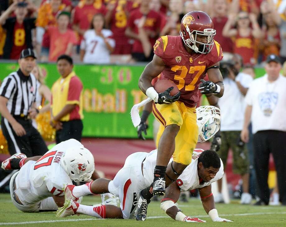 USC's Javorius Allen ran for 133 yards and a touchdown to help the Trojans thump Fresno State. Photo: Harry How, Getty Images