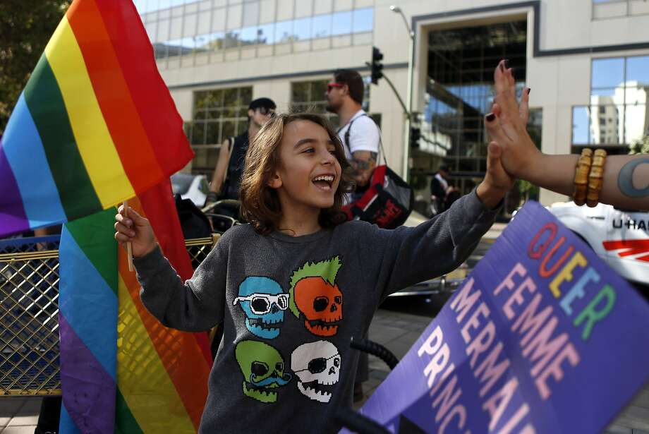 Chance Orterry, 8, high-fives Catey DeSantis on Broadway at Oakland's Gay Pride Parade, which was followed by a festival. Photo: Scott Strazzante, The Chronicle